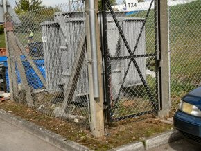 Chain link fencing protecting transformer at a Wellington factory