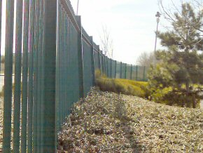 Green powder coated galvanised W-section palisade security fencing – Industrial Unit in Bridgwater.